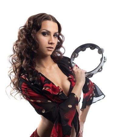 tambourine: giovane ragazza zingara ritratto giocare con tamburello isolato