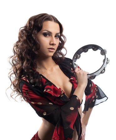 gypsy woman: young gipsy girl portrait play with tambourine isolated
