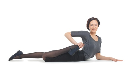 Young businesswoman lay in yoga asana isolated on white photo