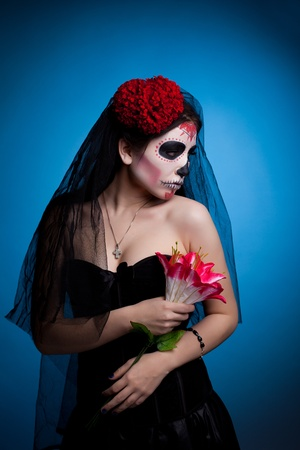 dead girl: Young woman face art dressed up for All Souls Day with flowers Stock Photo
