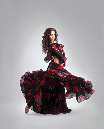 Woman dance in gypsy red and black costume isolated