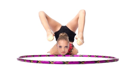Young beautiful girl  professional gymnast lay with hoop isolated photo