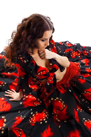 gypsies: young cute woman sit in gypsy black and red costume isolated Stock Photo
