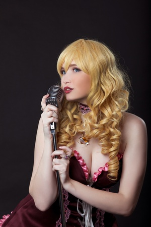 Young woman as beautiful singer cosplay anime character photo