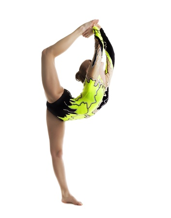 acrobat gymnast: Young beautiful woman professional gymnast stand on a splits - look at top isolated Stock Photo