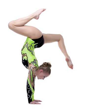 female gymnast: Young beautiful woman professional gymnast stand on hands isolated