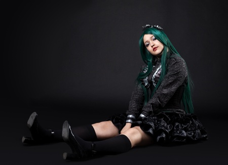 lewis: young fat girl portrait sit in dark cosplay anime character Stock Photo