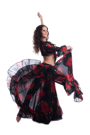 Woman dance in gypsy red and black costume isolated photo