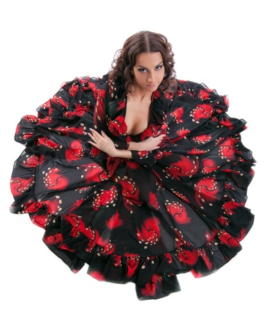 young cute woman sit in gypsy black and red costume isolated photo