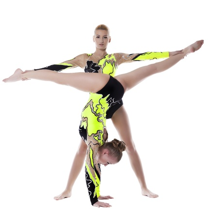 Two young acrobats woman stand on hands isolated Stock Photo - 12151595
