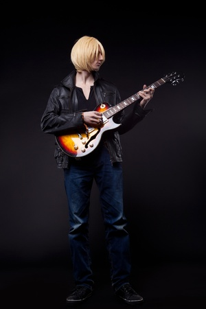 Young blond Man - guitar player cosplay anime character Stock Photo - 12151642