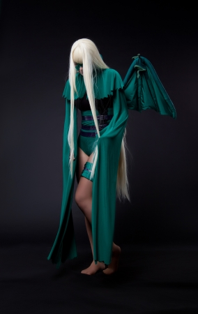 blond girl posing in green fury cosplay costume anime character photo