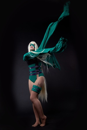 fiend: blond girl posing in green fury cosplay costume anime character Stock Photo