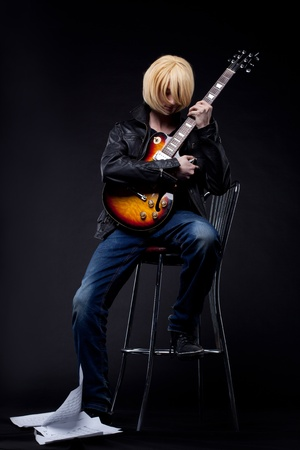 manga style: Young blond Man - guitar player cosplay anime character