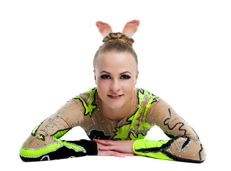 Young beautiful woman professional gymnast lay on background - look at camera isolated Stock Photo - 12151654