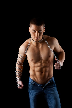 chaining: young athletic man posing with chain on hands Stock Photo