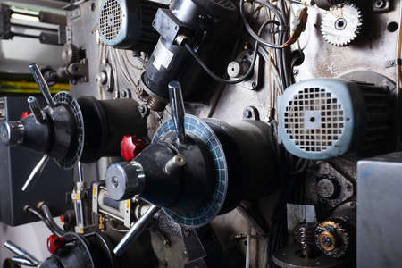 offset printer: close-up on complex detail of typography machine