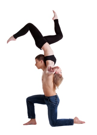 entertainer: Couple of young gymnast show stand on hand isolated