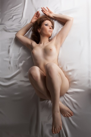 nude pretty girl: Beauty young woman lay on white silk bed Stock Photo