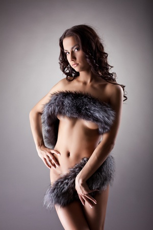 Beauty girl posing relaxed in fur look at camera Stock Photo - 12476967