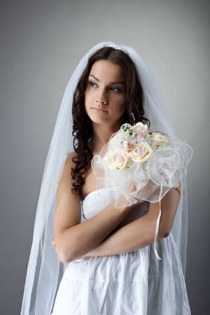 Beauty young woman like bride portrait with bunch of flowers photo