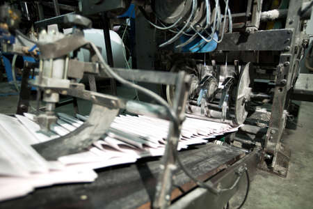 rotating: ready newspaper on production line in a print shop Stock Photo
