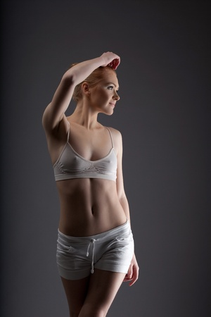 young sexy ballet girl posing in training cloth look at light photo
