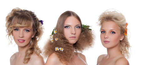 naked young women: Three beautiful naked young women with season flower hair style Stock Photo