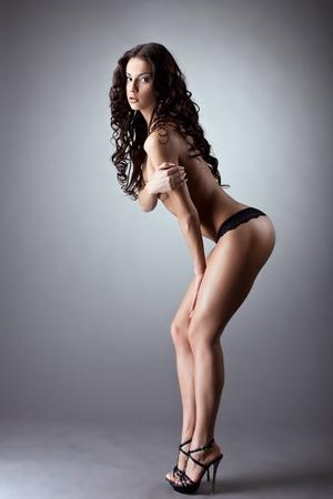 Beauty nude girl posing in black panties smile on camera