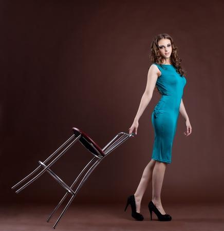 Beauty girl in fashion dress walk with bar chair Stock Photo - 13169006