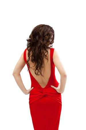 young woman in red dress with open spine and long hairs isolated Stock Photo - 12938709