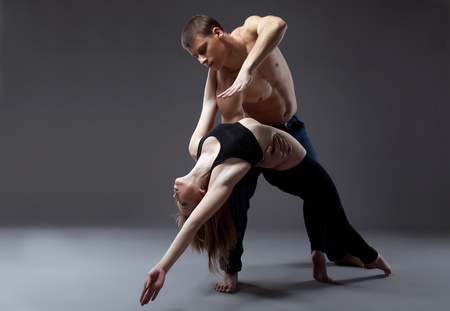 Couple of young gymnast posing in dance performance isolated photo