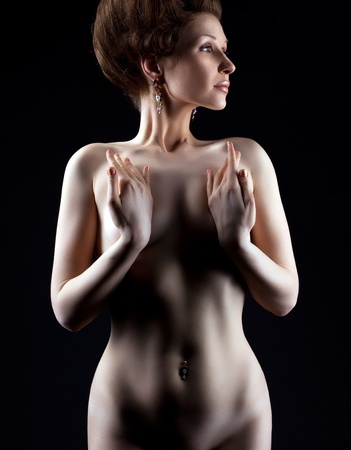 nude beauty girl retro art portait in dark hide breast with hands Stock Photo - 12867754