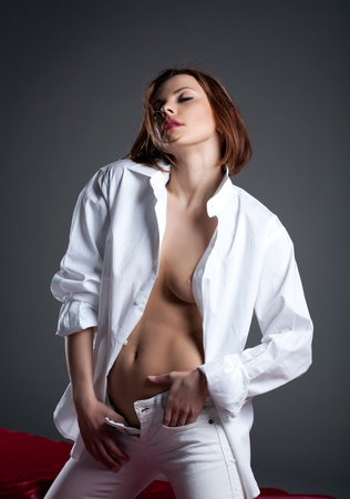 Beauty young woman in white shirt undress jeans with desire Stock Photo - 12901809