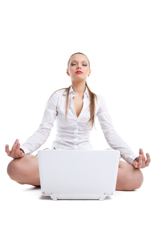 Beauty business woman sit with white laptop in lotos pose isolated Stock Photo - 12852184