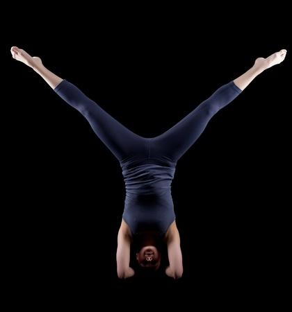 Woman in dark fitness dress stand on hands - yoga asana Stock Photo - 12867885
