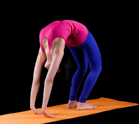 Woman exercise bridge yoga asana  on orange mat color fitness dress Stock Photo - 12867883