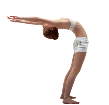 Young gymnast in white training costume on white isolated photo