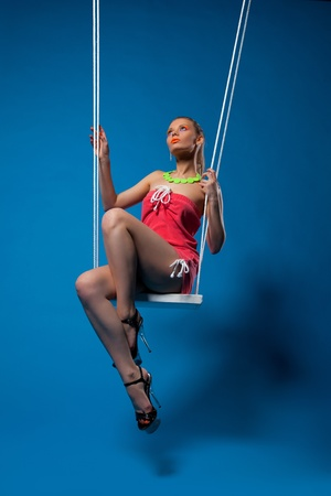 Beautiful girl with glow make-up sit on swing Stock Photo - 13125449