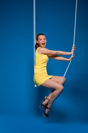 Sexy woman smile on swing with uv make-up pinup style Stock Photo - 13125452