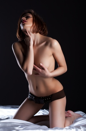 Beauty topless woman with perfect body take belt on buttocks Stock Photo - 13152038