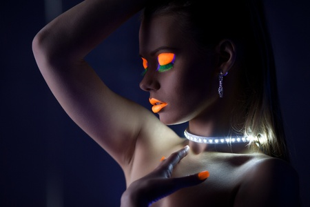 fluorescent lamp: Beauty woman dance with glow make-up under ultraviolet light