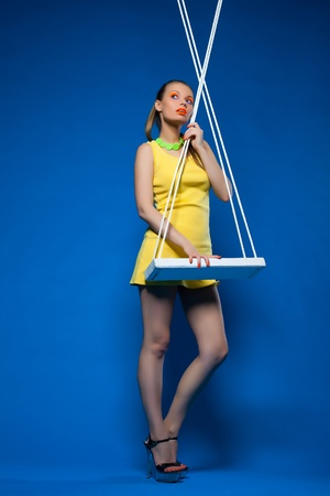 Beauty woman pinup style with bright make-up in swing Stock Photo - 13152083