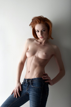 amazing red girl with perfect body posing topless in jeans Stock Photo - 13167397