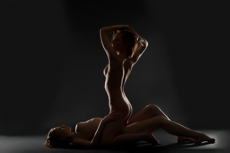 Two playful naked lesbian woman silhouette in dark Stock Photo - 13167328