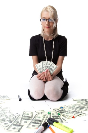 Happy blond business woman show income dollars isolated photo