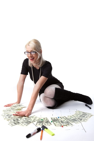 Young blond business woman count money and graph isolated photo