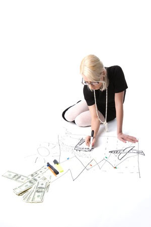 Blond business woman dream about vacation on financial graph isolated photo