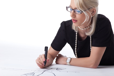 Cute blond woman thnking on drawing graph isolated photo