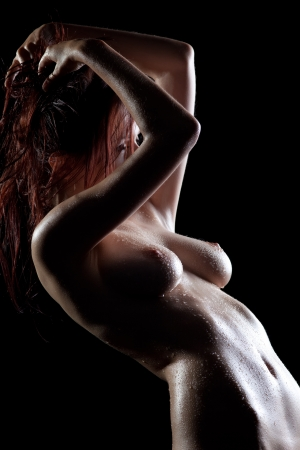 naked sexy woman silhouette in dark with drops on body Stock Photo - 13804213
